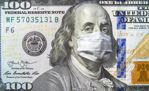COVID-19 coronavirus in USA, 100 dollar money bill with face mask. Coronavirus affects global stock market.